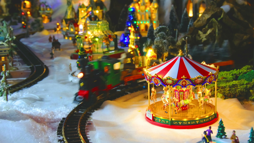 vintage toy store with carousel train and balloon in white snow christmas set . Royalty-Free Stock Footage #1041092779