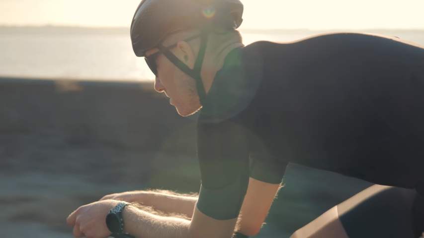 Cyclist Professional Fit Man On Triathlon Bicycle.Triathlete Training On Bike.Cycling Exercise On Bike.Cyclist Rider In Helmet And Sportswear Riding Workout At Sunset On Triathlon Time Trial Cycling Royalty-Free Stock Footage #1041097552