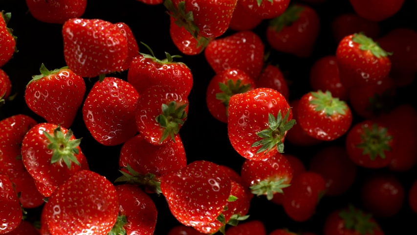 Super slow motion of strawberries isolated on black background. Filmed on high speed cinema camera, 1000 fps. | Shutterstock HD Video #1041106318