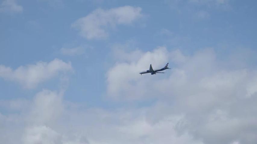 The plane flies through the sky.4K   Shutterstock HD Video #1041150391