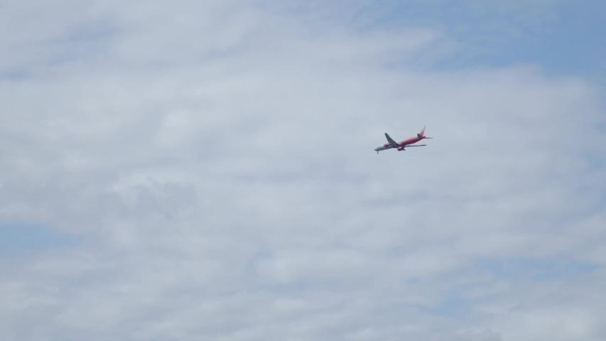The plane flies through the sky.4K   Shutterstock HD Video #1041150775