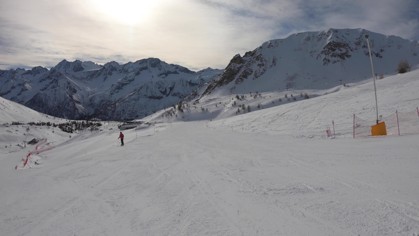 Ponte di Legno, Tonale, Italy. Skiing on the slopes in a wonderful day. POV from the skier. Point of view from the ski helmet. Italian Alps   Shutterstock HD Video #1041160573