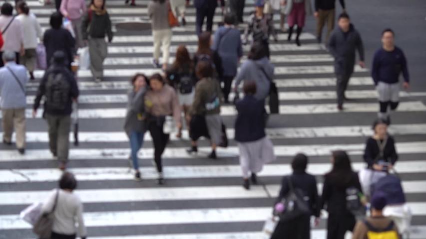 blur People walking crosswalk at Umeda in Japan #1041177361