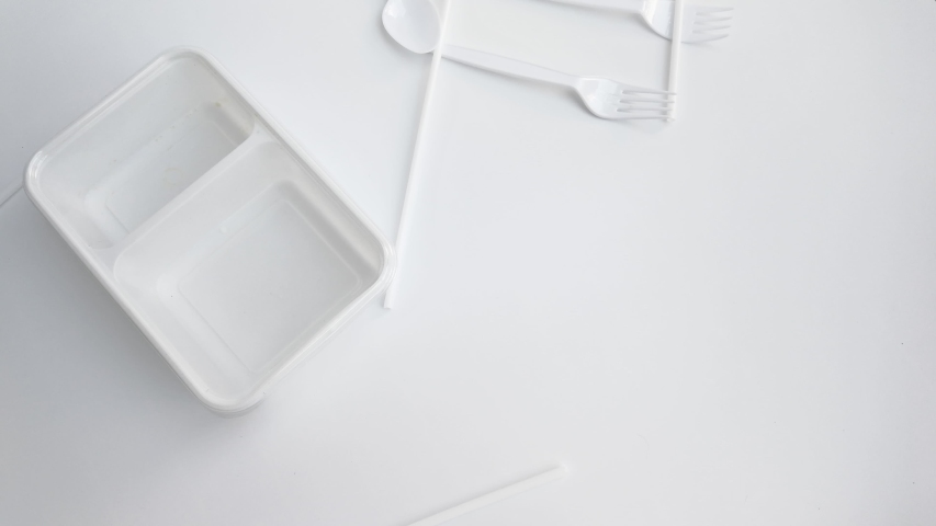 Stop using plastic. Plastic waste collection Plate, bowl, Spoon and fork, lunch box, bottle Made of Plastic. Concept of Recycling plastic and ecology problem (Environment concept). | Shutterstock HD Video #1041188638