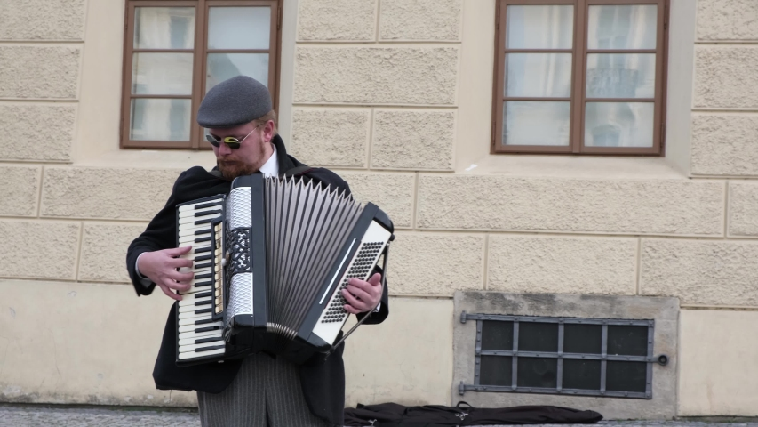 PRAGUE, CZECH REPUBLIC - OCTOBER, 2019.  Street musician play the accordion in tourist center of old city. Footage with Sound.
