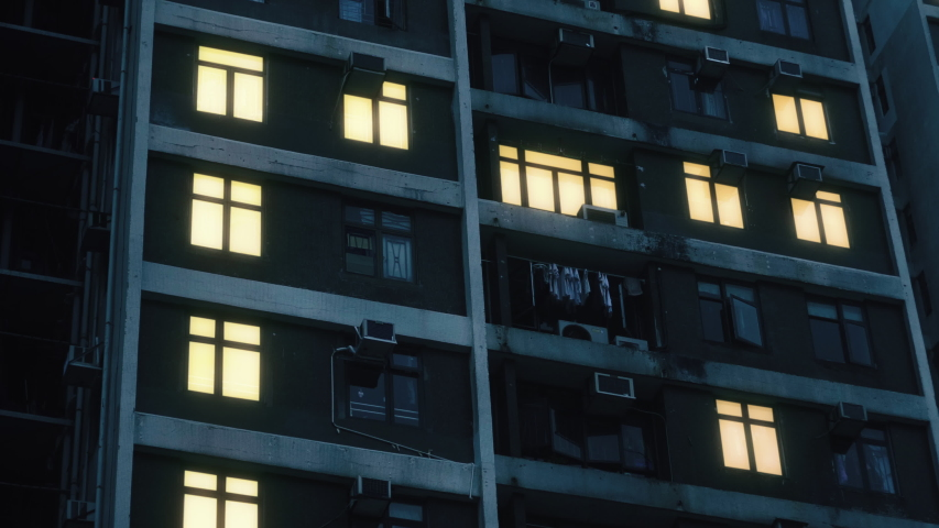 Power outage blackout in a suburban neighborhood. Close telephoto view of apartment windows in a big residential building.  Relevant to coronavirus, covid-19, sars-cov-2 corona virus viral outbreak. Royalty-Free Stock Footage #1041199276