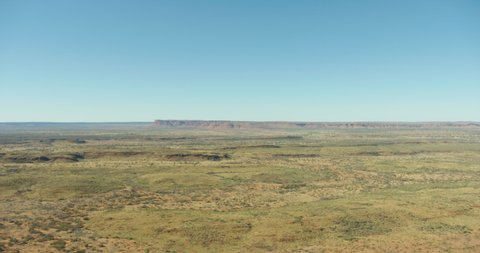 Aerial view Red Centre mountain plateau interior Outback bushlands of Northern Australia travel and tourism a remote dry land habitat of Wildlife Watarrka National Park