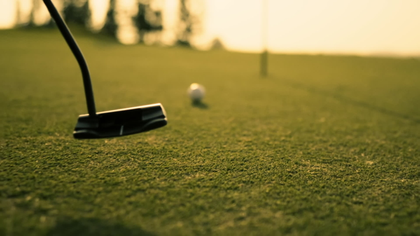 Putting Golf Ball on green in golf course hitting the golf ball to hole for birdie score, sports relax in holidays summer vacation at sunset golden time, cinematic Slow motion footage Royalty-Free Stock Footage #1041219301
