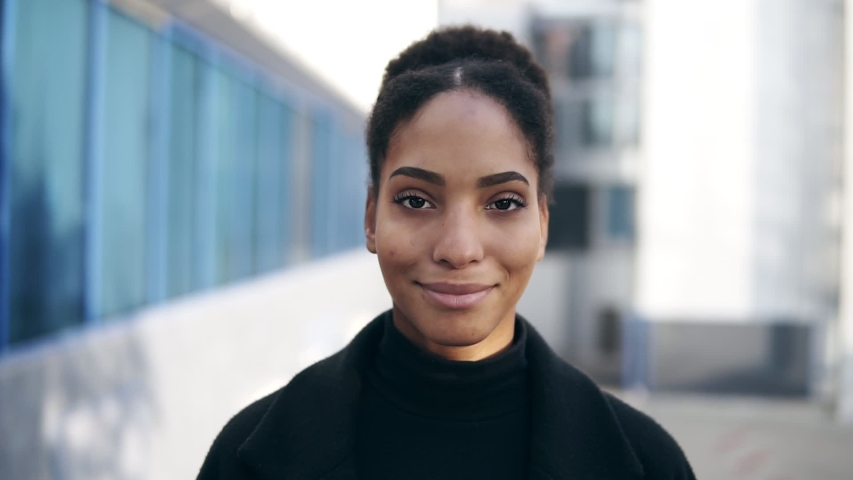 Portrait of beautiful stylish african american woman smiling at camera looking confident. Wearing black clothes, urban city background. Real people series | Shutterstock HD Video #1041220315