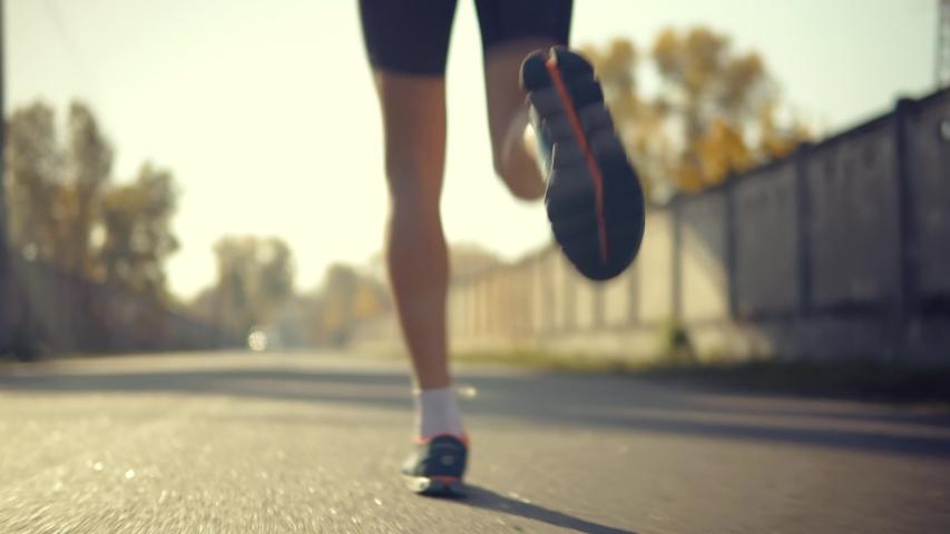 Running Man On Road Half Marathon.Triathlete Jogger Ready For Marathon And Hard Training Workout Running Competition.Runner Man In Sportswear Preparing To Triathlon And Sprinting In Park On Fall.   Shutterstock HD Video #1041229918