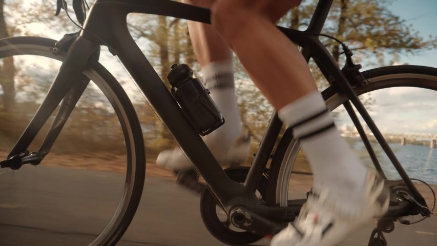 Gear System And Bike Wheel Rotation.Cyclist Legs Triathlete Pedaling And Exercising Before Triathlon.Cyclist Twists Pedals And Riding On Bicycle.Cycling Athlete Cardio Endurance Workout.Sport Concept | Shutterstock HD Video #1041230422