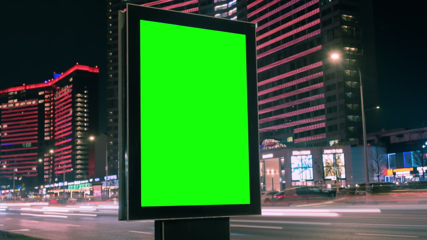 Modern billboard with a green screen on a busy highway with traffic, neon lights, timelapse of traffic at night, Moscow, Russia Royalty-Free Stock Footage #1041238795