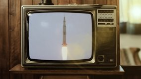 1969. Historical Footage Of The Saturn V Rocket Launch Of Apollo 11 Mission, on a Vintage Television. Elements of this Video furnished by NASA.