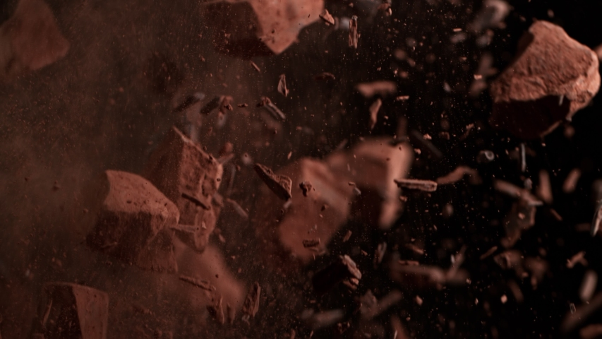 Super Slow Motion Shot of Raw Chocolate Chunks and Cocoa Powder after Being Exploded at 1000fps.