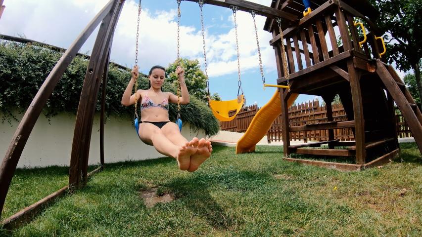 Happy Teen Girl On Swing In Slow Motion #1041271096