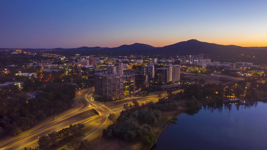 Aerial drone hyperlapse from dawn to sunrise over Canberra city, the Capital of Australia