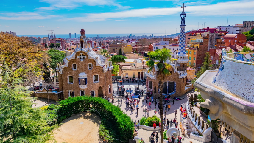 Barcelona, Spain: Timelapse of the Dragon Stairway and the Casa del Guarda at Park Guell.  | Shutterstock HD Video #1041302476