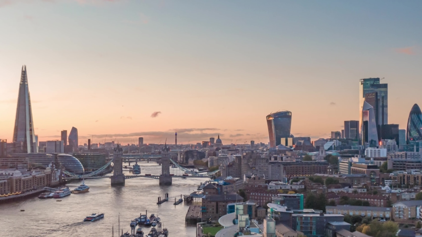 London, United Kingdom-10.15.2019: Aerial Drone Hyperlapse Helicopter View Of Tower Bridge London City Skyline The Shard Sky Garden And Thames River Time Lapse At Sunset