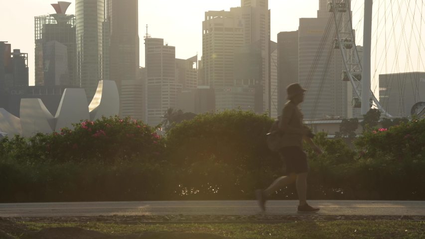 Singapore, November 20, 2019. (Selective focus) Silhouette of people walking, running and cycling in a public park during sunset in Singapore. Singapore, an island city-state off southern Malaysia.