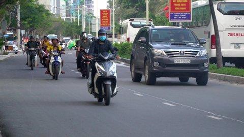 NhaTrang, Vietnam, November,10-2018. Nha Trang Street. Stream cars and scooters.