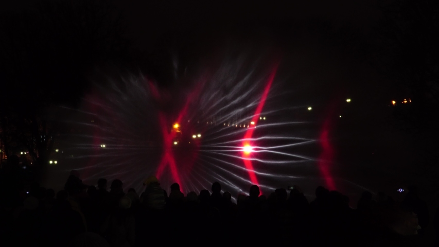 Riga, Latvia - November 18, 2019. Festival of light Staro Riga. Multimedia performance. Lasers show in town at night. Spatial 3D light abstractions with images | Shutterstock HD Video #1041335575