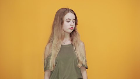 Beautiful blonde caucasian young lady wearing pretty shirt staying over isolation white background pointing away his finger directly, showing NO gesture