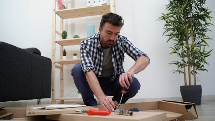 Video about stressed man and do it yourself furniture assembly problem