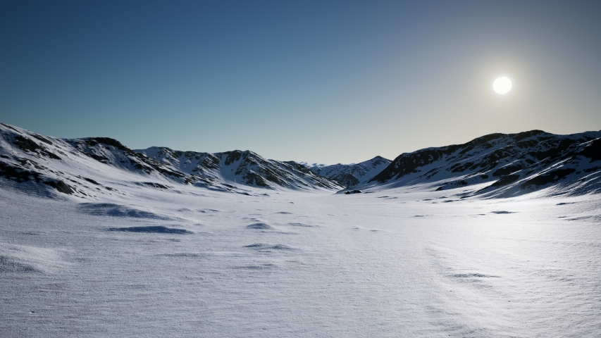 Aerial Landscape of snowy mountains and icy shores in Antarctica