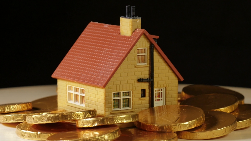 Toy house surrounded with Euro money rotating on black background | Shutterstock HD Video #1041408262