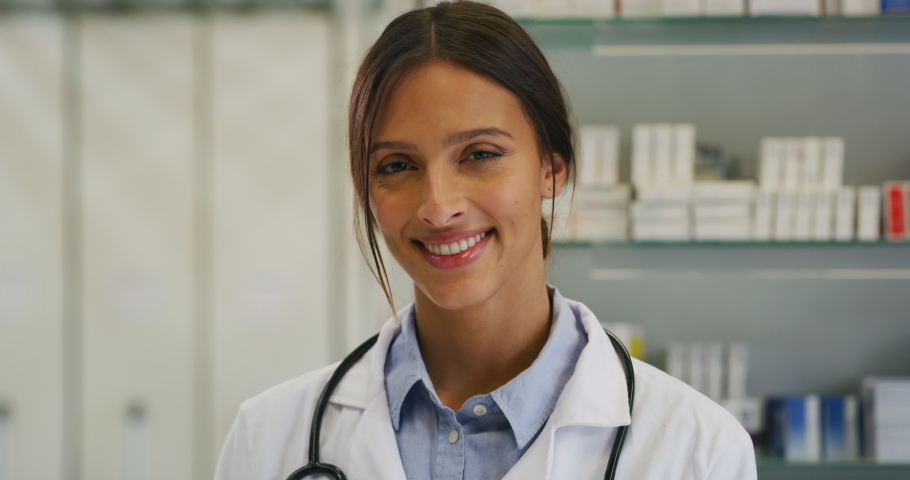 Close up of an young female pharmacist consultant is smiling in camera in a drug store.   Shutterstock HD Video #1041410203