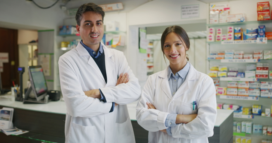 The young pharmacists consultants are smiling in camera in a drug store. | Shutterstock HD Video #1041410269