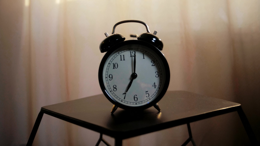 A classic mechanical alarm clock rings early in the morning and wakes up to work | Shutterstock HD Video #1041431128