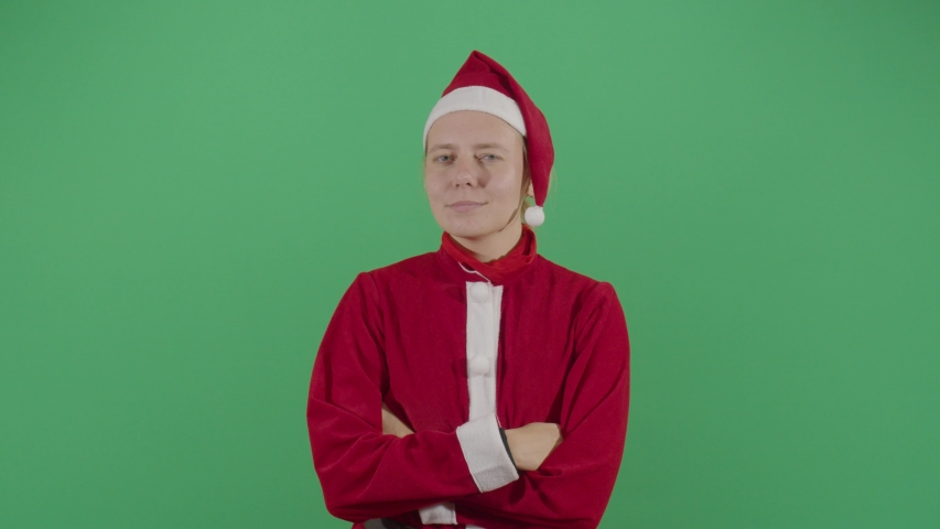 female santa claus claus sending kisses to the gathering studio isolated shot against green screen scene #1041443785