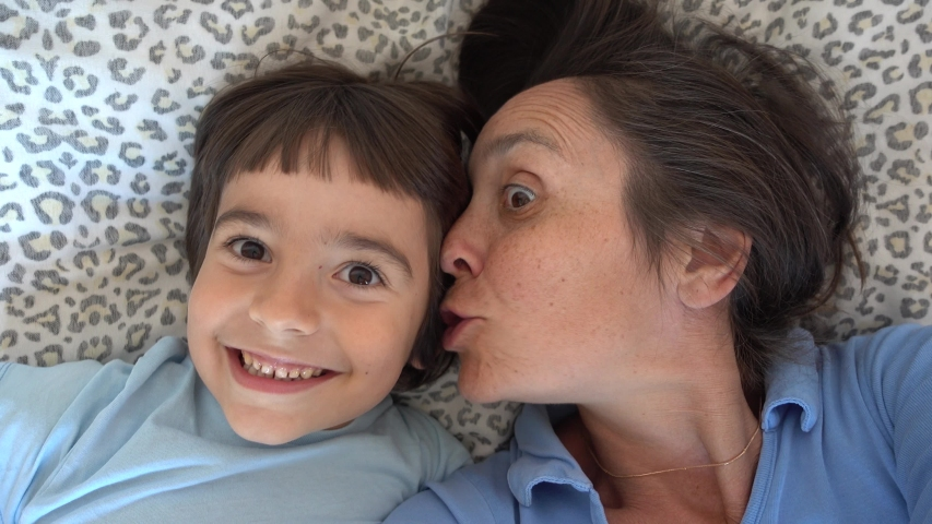4K Selfie Mother whisters in ear of her son some secrets