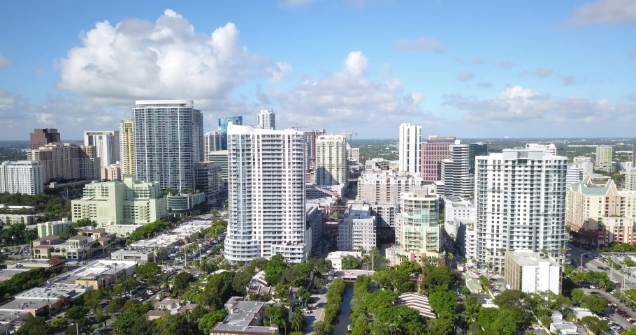 Drone footage of Fort Lauderdale Florida.  Downtown condominiums and apartment buildings pass by with parallax.   Shutterstock HD Video #1041464350