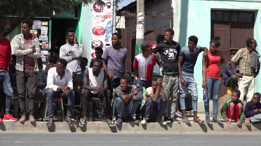 MEKELE, ETHIOPIA – MARCH 2019: Audience watches local cycle competition near Mekele in Ethiopia