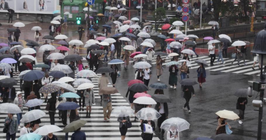 Tokyo, Japan. Circa October 2019: People walking in Shibuya Crossing, Tokyo, Japan. Rain, season, monsoon, crowded, crowd, crosswalk #1041491794
