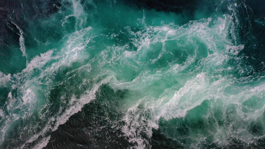 Waves of water of the river and the sea meet each other during high tide and low tide. Whirlpools of the maelstrom of Saltstraumen, Nordland, Norway   Shutterstock HD Video #1041515743