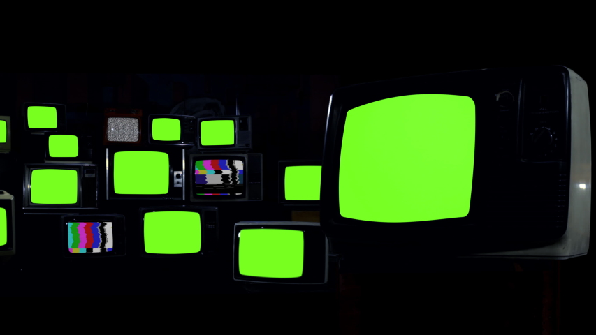 """Retro TVs turning on Green Screens. Dark Tone. You can replace green screen with the footage or picture you want. You can do it with """"Keying"""" effect in After Effects. 4K Resolution."""