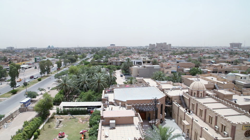 Baghdad skyline with a christian church at right, Iraq