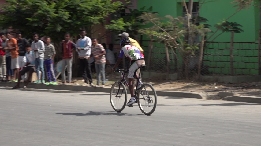 MEKELE, ETHIOPIA – MARCH 2019: Slow motion of leading bicycle rider during local speed cycling race near Mekele in Ethiopia