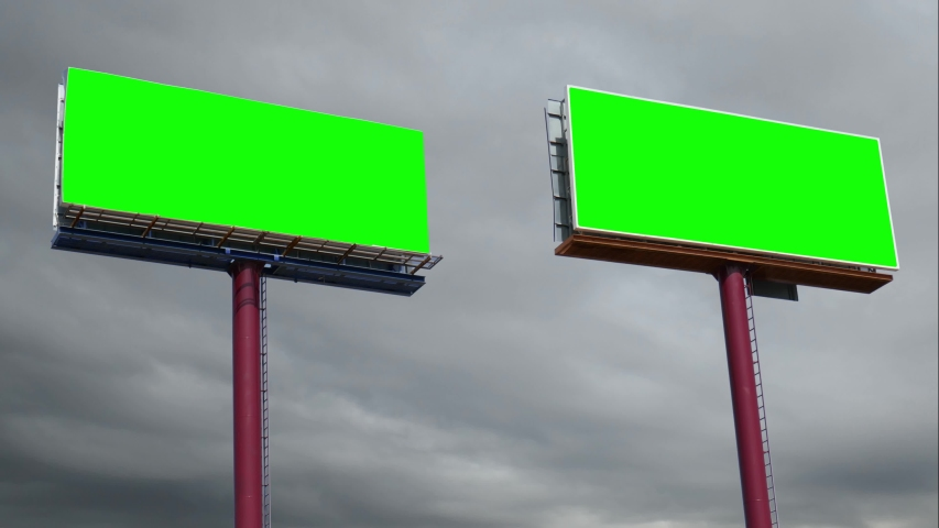 Green screen: Two signboard in the foreground with chroma key board for advertisement and time lapse of sky covered with clouds in the background. | Shutterstock HD Video #1041539884