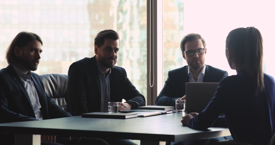 Male hr management employers team of three businessmen talking to female seeker at job interview asking questions making first impression, gender inequality, unequal rights and recruitment concept Royalty-Free Stock Footage #1041547654