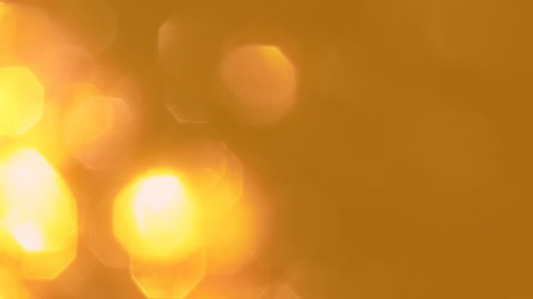 Golden sparkles. Shiny spangles. Blur yellow glowing sequins pattern background.