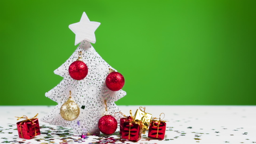 Confetti falls on a Christmas tree, slow motion. Xmas and New Year concept.  | Shutterstock HD Video #1041582829
