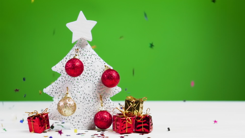 Confetti falls on a Christmas tree, slow motion. Xmas and New Year concept.  | Shutterstock HD Video #1041582832