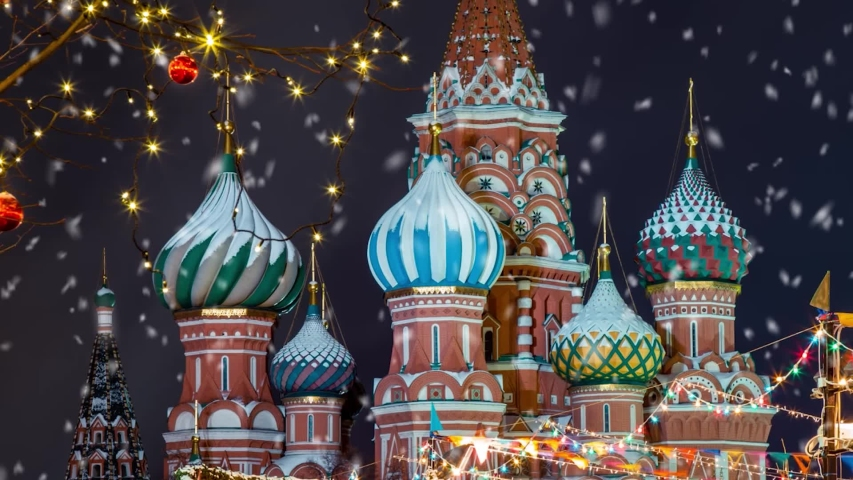Christmas card, New Year Celebration Card. Moscow Russia. Snowy night with the view of saint basil s cathedral. New year decorations