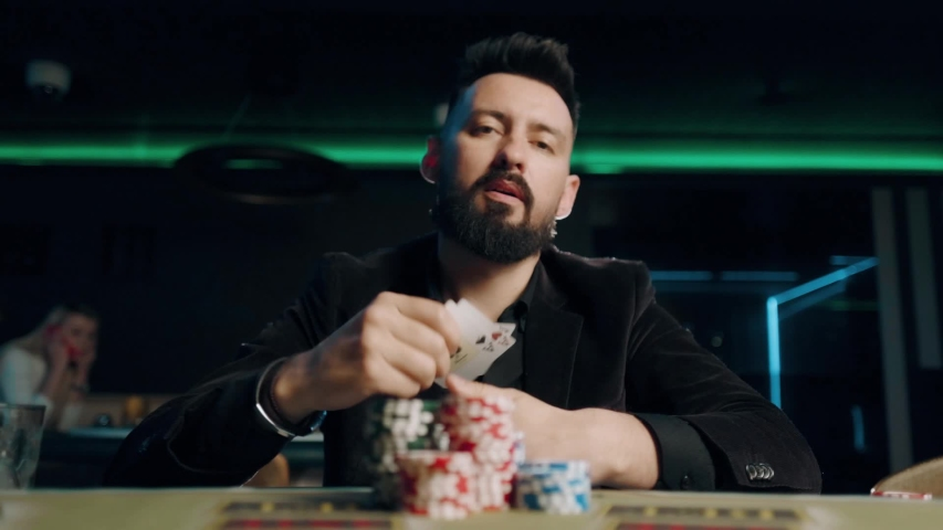 Bearded man is playing poker in casino. Man is winning and rejoice | Shutterstock HD Video #1041599563