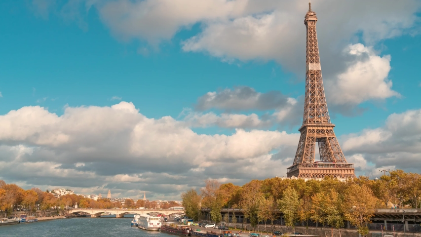 Amazing timelapse of the Eiffel tower  from Bir-Hakeim bridge, over the river Seine , Paris, France, at a cloudy but sunny autumn day | Shutterstock HD Video #1041615043