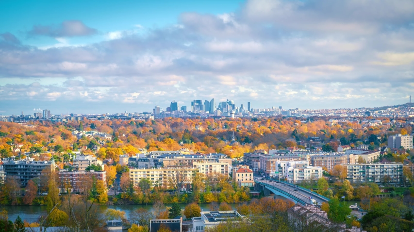 Zoom in to skyscrapers of Paris business district La Defense. Timelapse at a sunny autumn day with blue cloudy sky. From Saint-Germain-en-Laye, west of Paris, France | Shutterstock HD Video #1041616867